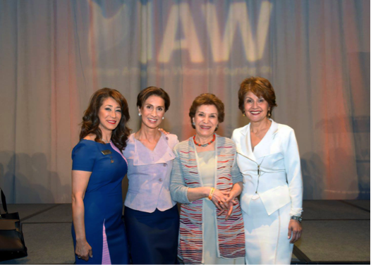 Leaders and activists pose at IAWF event.